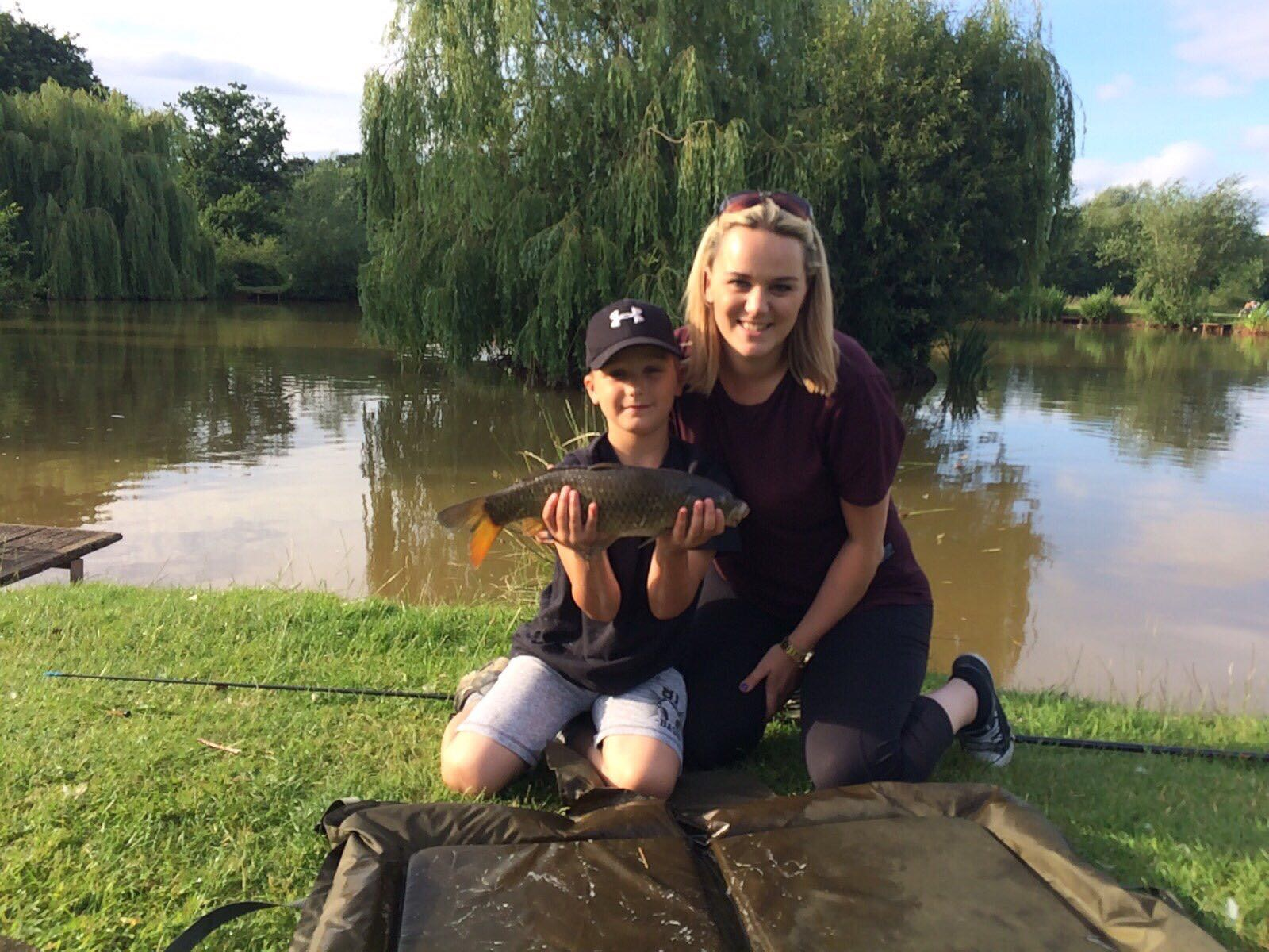 Fishing Mum Stacie Logan and her son with a catch