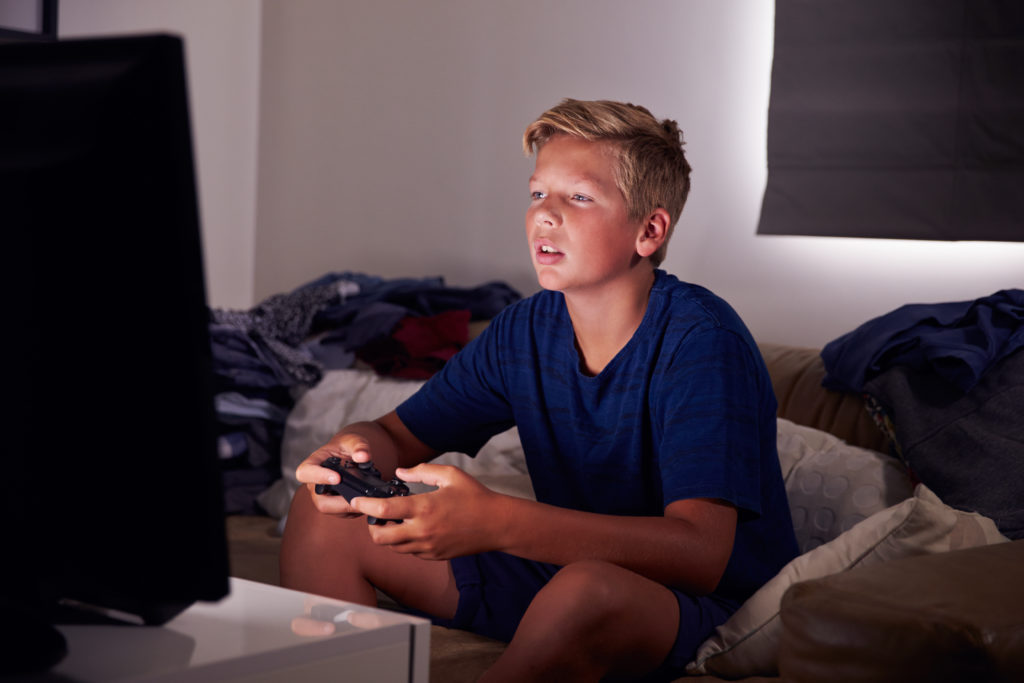 Kid addicted to playing video games